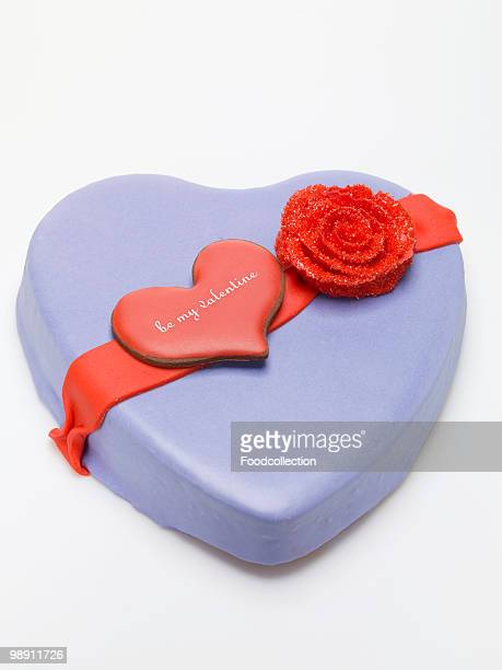 Heart shaped marzipan cake on white background, close-up