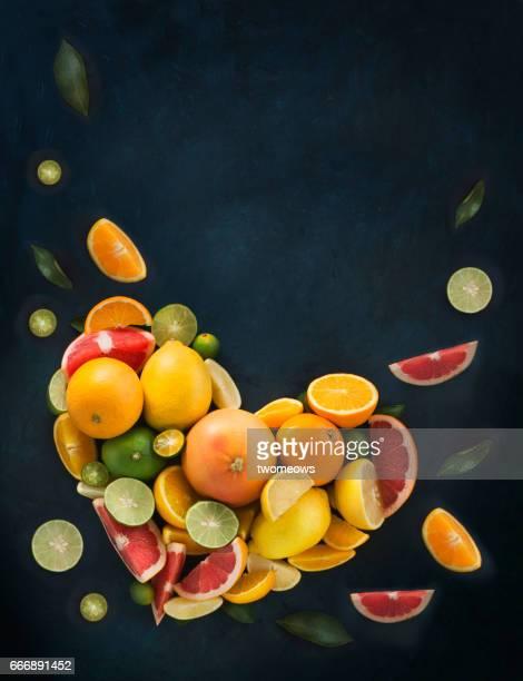 Heart shaped mix citrus fruits pile.