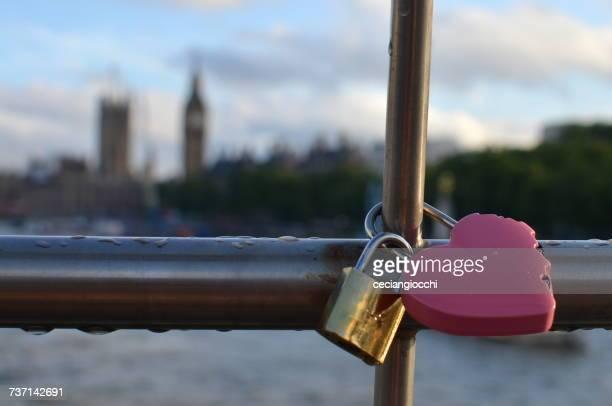 Heart shaped padlock locked on a bridge, London, England, UK