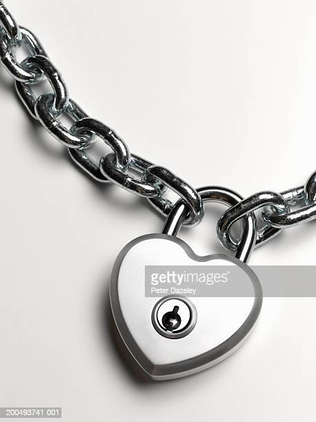 Heart shaped padlock on chain, close-up