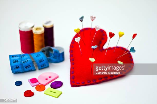 heart shaped pin cushion - catherine macbride stock pictures, royalty-free photos & images