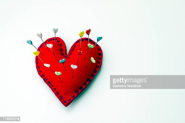 heart shaped pin cushion with heart pins - catherine macbride stock pictures, royalty-free photos & images