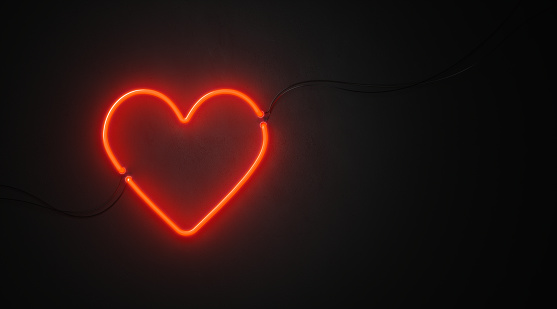 Heart Shaped Red Neon Light On Black Wall - Valentines Day Concept 1062646660