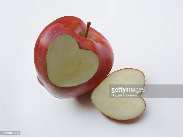Heart shaped slice of red apple