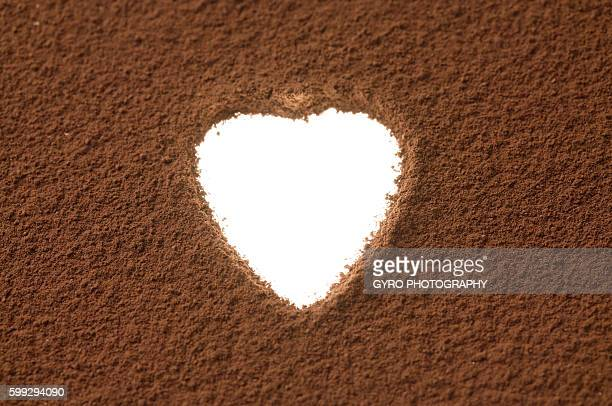 Heart shaped space in cocoa powder