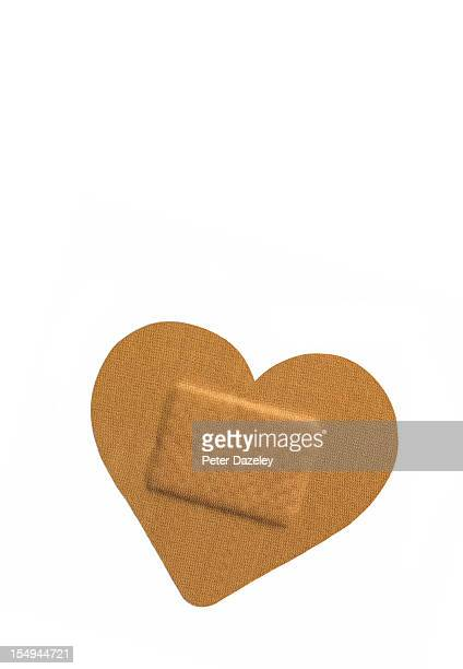 heart shaped sticking plaster - band aid stock pictures, royalty-free photos & images