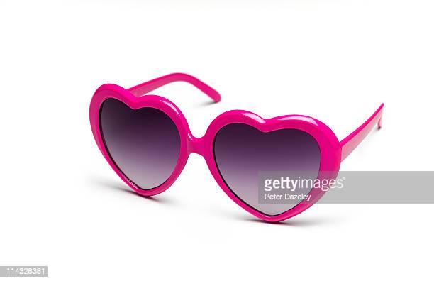 heart shaped sunglasses on white background - sunglasses stock-fotos und bilder