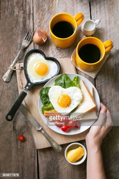 heart shaped sunny side up breakfast with coffee. - chinese mothers day stock pictures, royalty-free photos & images