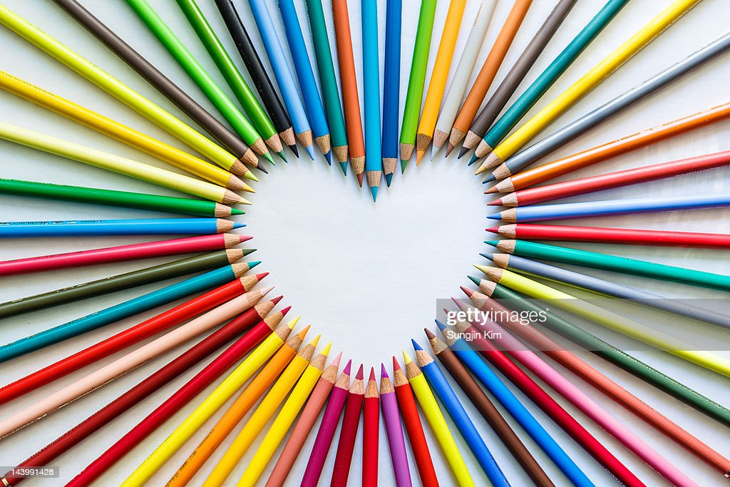 Heart shaped with color pencils on white background.