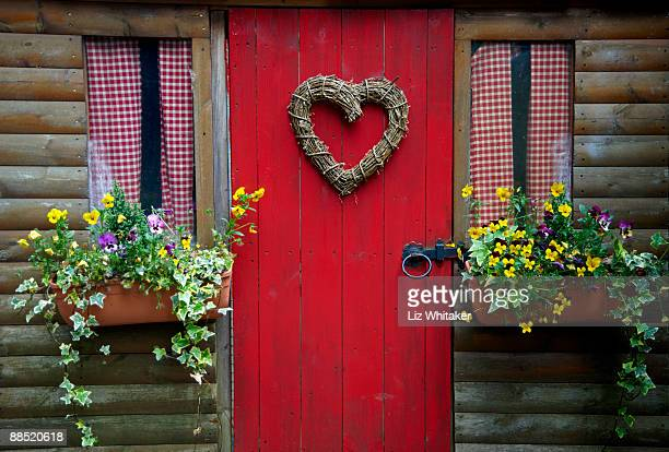 Heart shaped wreath on door of shed