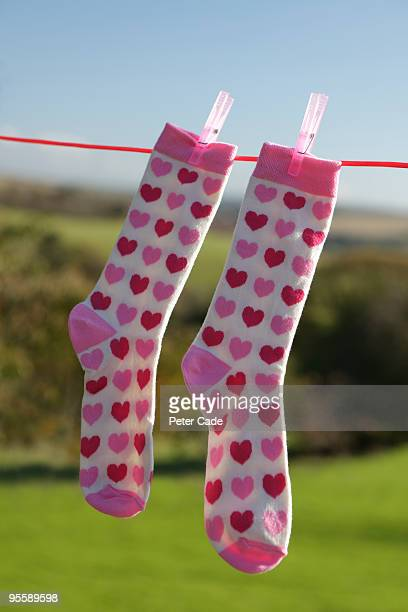 heart socks hanging on line - pair stock pictures, royalty-free photos & images