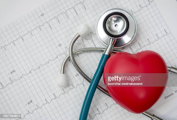 heart ,stethoscope on cardiogram report of cardiology patient. cardiologist and medical concept - heart health stock pictures, royalty-free photos & images