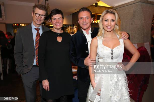 Heart surgeon Prof Dr Peter Ewert and his wife Nicole Ewert and Stefan Mross and his girlfriend AnnaCarina Woitschack during the Christmas Charity...