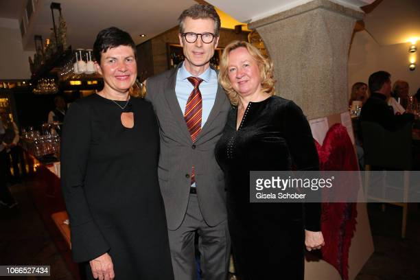 Heart surgeon Prof Dr Peter Ewert and his wife Nicole Ewert and Sylvia Paul during the Christmas Charity Dinner hosted by StefanMross...