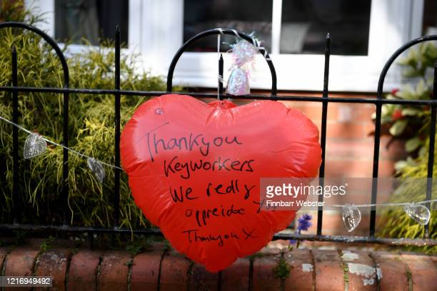 Heart thanking keyworkers is seen outside a house on April 05, 2020 in Weymouth, United Kingdom. The Coronavirus pandemic has spread to many...