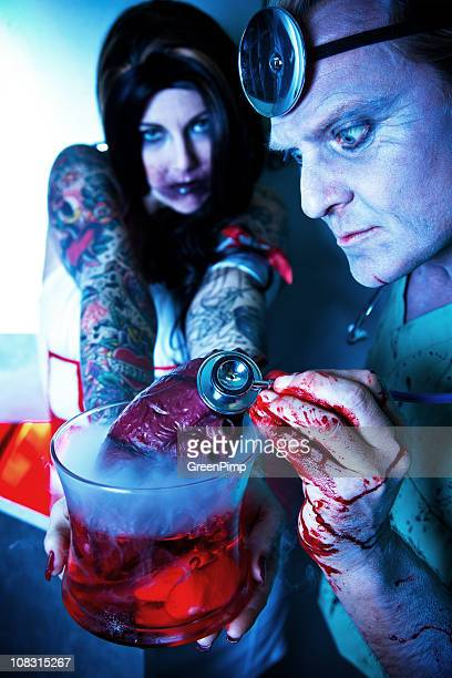 heart transplant - bloody heart stock photos and pictures