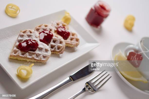Heart waffles and marmalade on rectangular plate