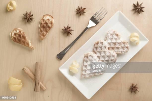 Heart waffles, lemon zest, powdered sugar