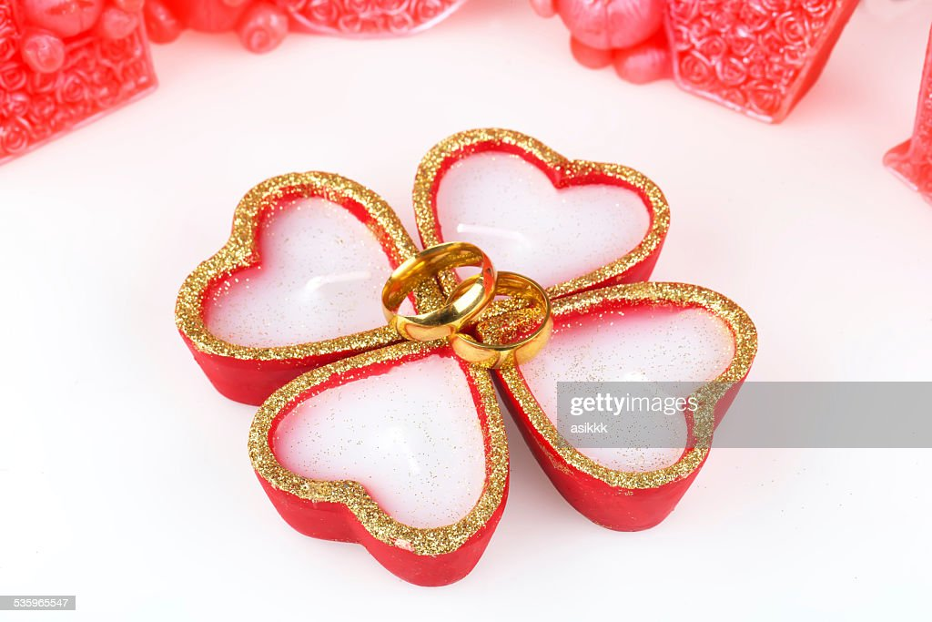 heart, wedding rings, candle : Stock Photo
