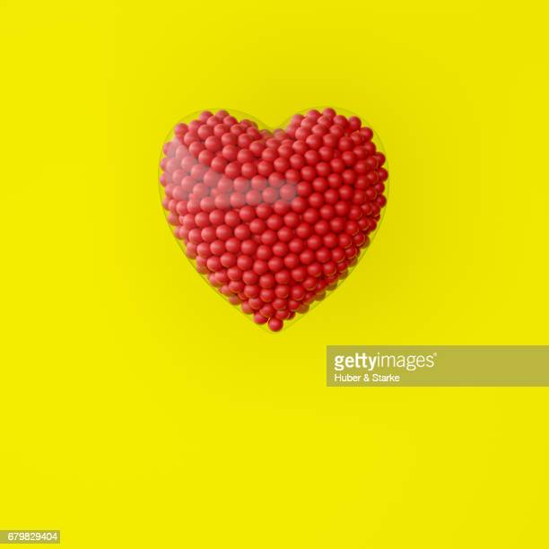 heart with lots of red spheres - kreativität stock pictures, royalty-free photos & images