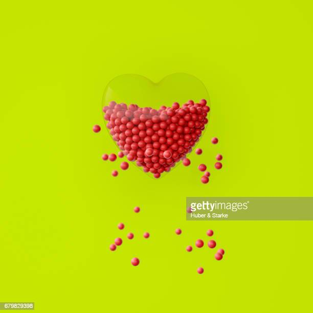 heart with lots of red spheres, some are outside - kreativität stock pictures, royalty-free photos & images