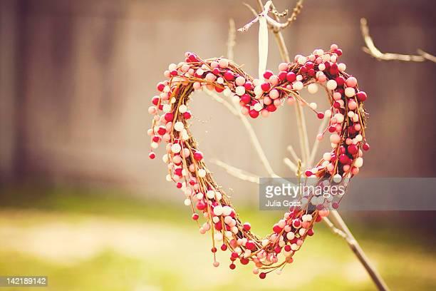 Heart wreath hanging on tree