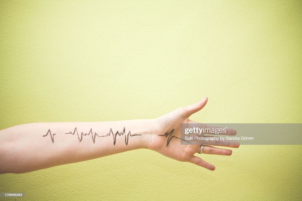 Heartbeat with hand : Stock Photo