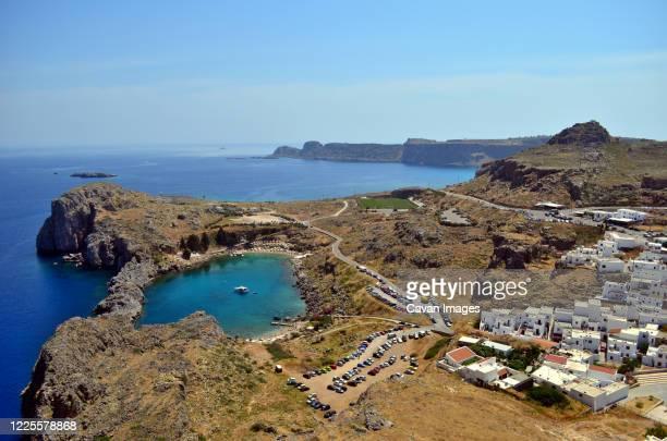 heart-like laguna with the lindos town on rhodes island - lindos stockfoto's en -beelden