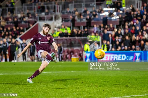 Hearts Aidan Keena scores the winning penalty during the penalty shootout in the Betfred Cup Quarter-Final match between Heart of Midlothian and...