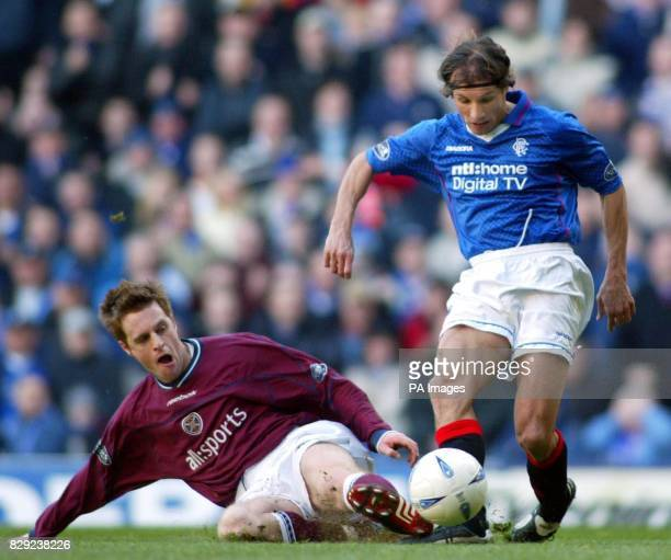 Hearts' Alan Maybury tackles Claudio Caniggia of Rangers during their Bank of Scotland Premier League match at the Ibrox Stadium Glasgow