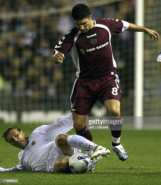 Hearts Bruno Aguiar is tackled by Daniel Kolar of Sparta Prague during the UEFA Cup first round first leg match between Hearts and Sparta Prague at...