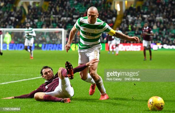Hearts' Connor Randall slides in to challenge Celtic's Scott Brown