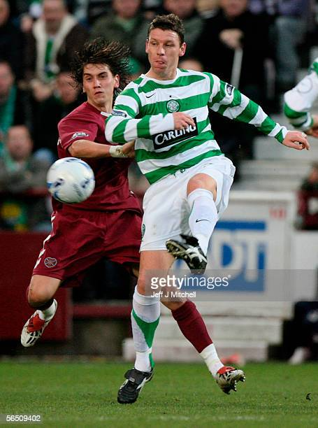 Hearts Deivdas Cesnauskis tackles Celtic's Alan Thompson during the Scottish Premier division match between Hearts and Celtic at Tynecastle stadium...