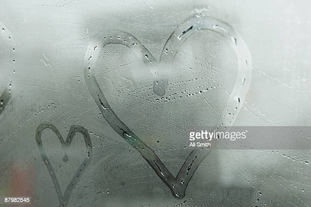 Hearts drawn on fogged window