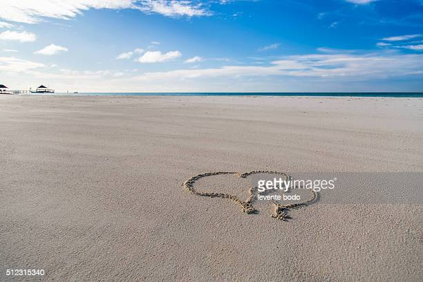 Hearts drawn on the beach sand