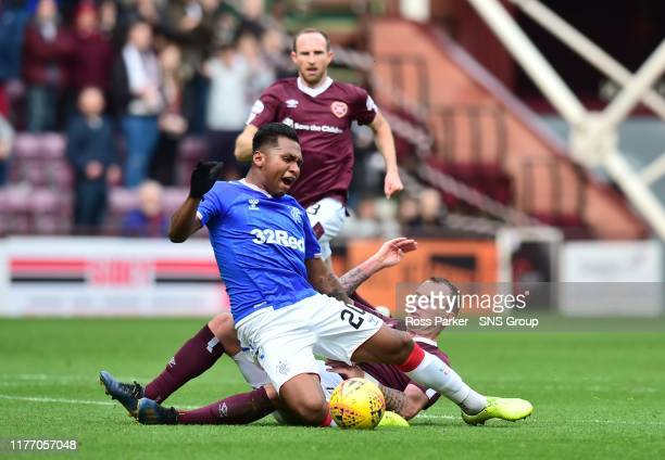 Hearts' Glenn Whelan fouls Rangers' Alfredo Morelos and he is booked by referee Kevin Clancy during the Ladbrokes Premiership match between Heart of...