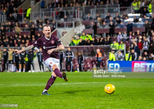Hearts Glenn Whelan scores a penalty during the penalty shootout in the Betfred Cup Quarter-Final match between Heart of Midlothian and Aberdeen at...
