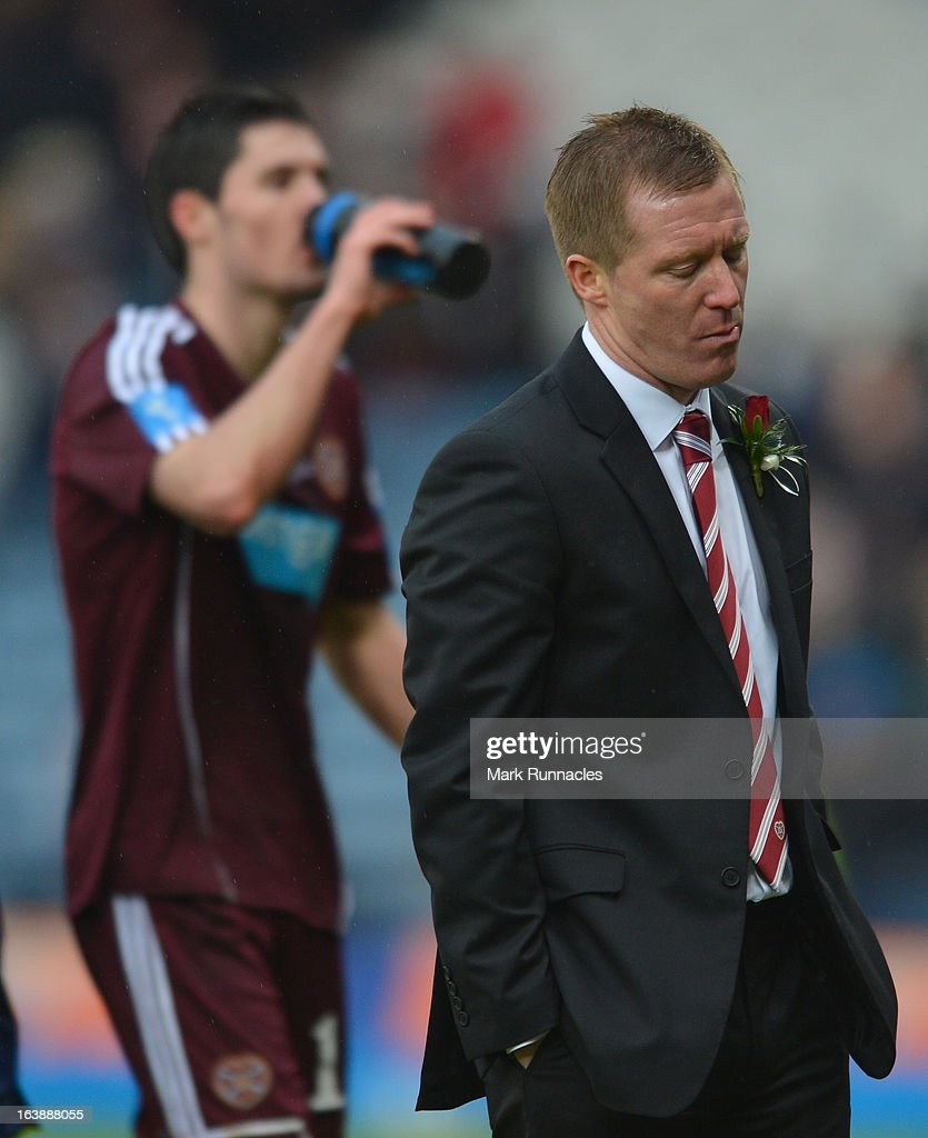 Hearts manager Gary Locke dejected after his side lost in the Scottish Communities League Cup Final between St Mirren and Hearts at Hampden Park on March 17, 2013 in Glasgow, Scotland.