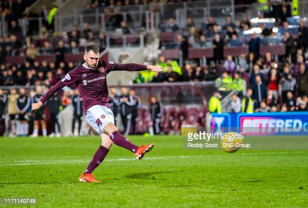 Hearts Michael Smith scores a penalty during the penalty shootout in the Betfred Cup Quarter-Final match between Heart of Midlothian and Aberdeen at...
