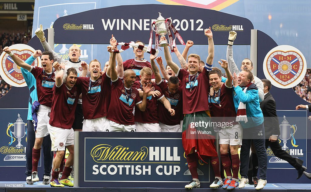 Hearts players celebrates with the trophy after winning the William Hill Scottish Cup Final between Hibernian and Hearts at Hampden Park on May 19, 2012 in Glasgow, Scotland.