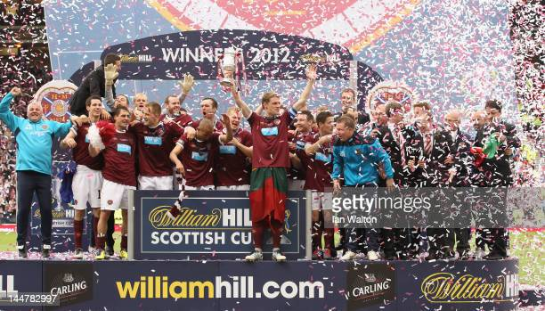 Hearts players celebrates with the trophy after winning the William Hill Scottish Cup Final between Hibernian and Hearts at Hampden Park on May 19...