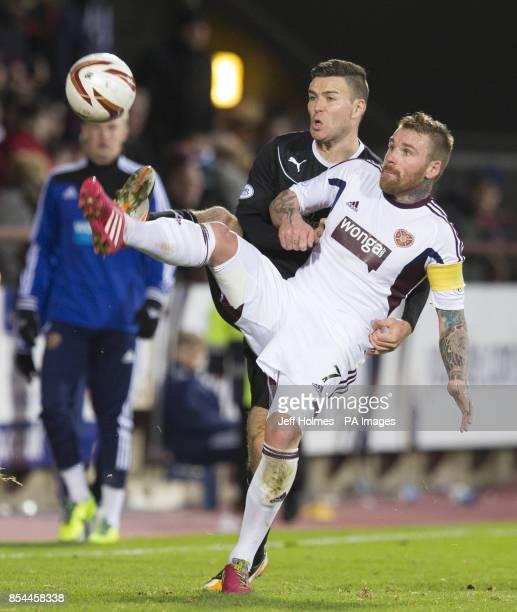 Hearts Ryan Stevenson in action with Motherwell's Simon Ramsden during the Scottish Premiership match at Tynecastle Stadium Edinburgh