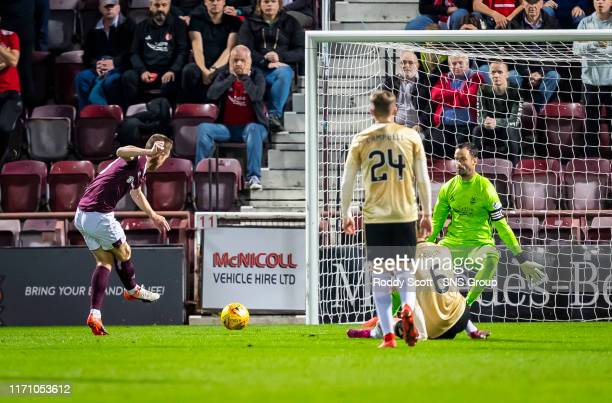 Hearts Steven MacLean scores to make it 1-0 during the Betfred Cup Quarter-Final match between Heart of Midlothian and Aberdeen at Tynecastle Park on...