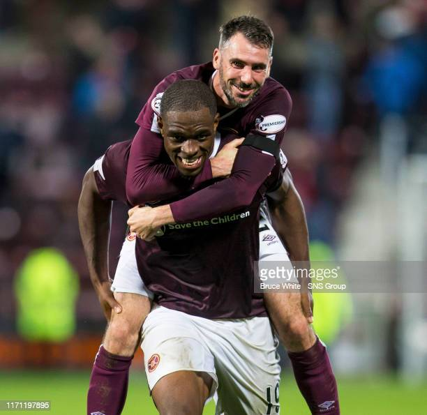 Hearts Uche Ikpeazu celebrates with team mate Michael Smith at full time of the Betfred Cup QuarterFinal match between Heart of Midlothian and...