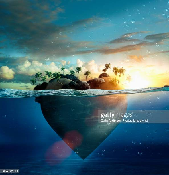 heart-shape island floating in tropical ocean - island stock pictures, royalty-free photos & images