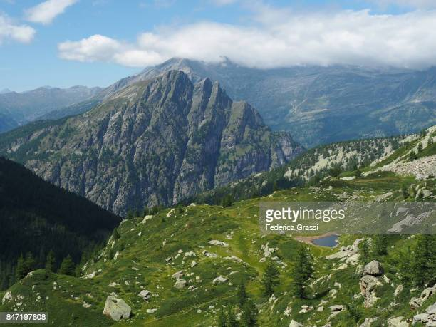 heart-shaped alpine lake in the swiss lepontine alps - heart month stock photos and pictures