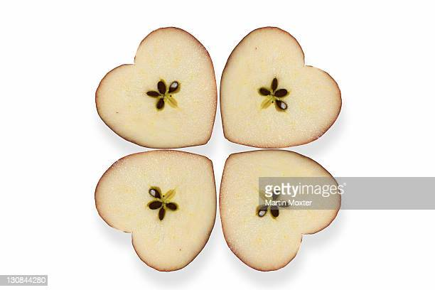 Heart-shaped apples making a clover