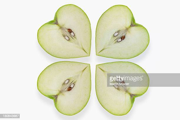 Heart-shaped apples placed like a clover leaf