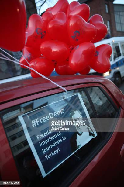 Heartshaped balloons and a photograph of Deniz Yucel a GermanTurkish journalist imprisoned in Turkey decorate a car before a protest tour of cars and...