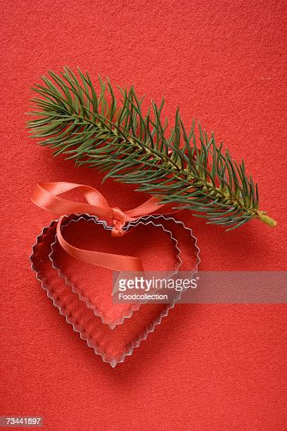 Heart-shaped biscuit cutters and fir sprig